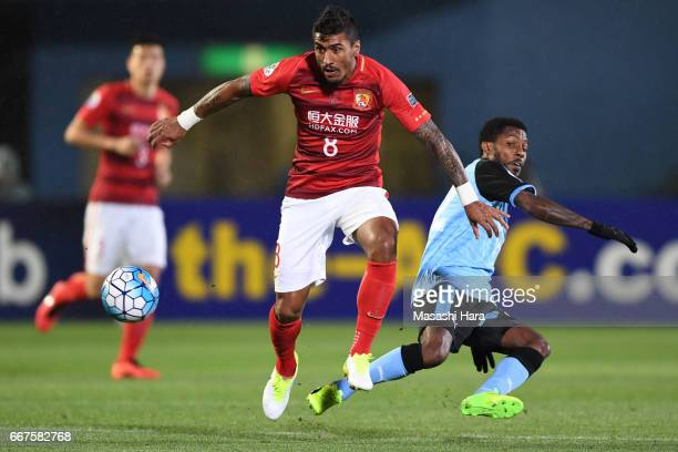 Paulinho of Guangzhou Evergrande and Rhayner Santos Nascimento of Kawasaki Frontale compete for the ball during the AFC Champions League Group G...