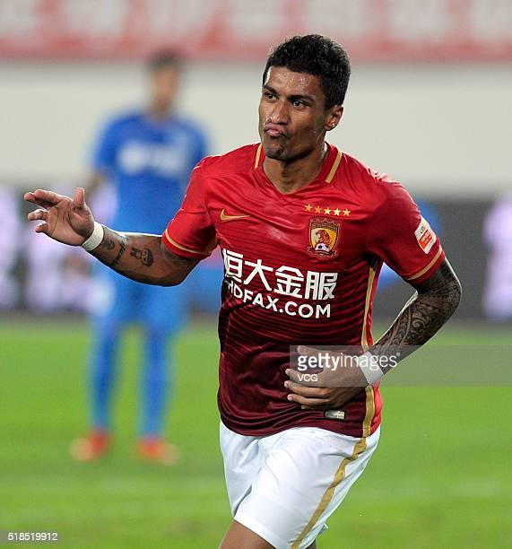 Paulinho of Guangzhou Evergrande celebrates a ball during the round three match of CSL Chinese Football Association Super League between Guangzhou...