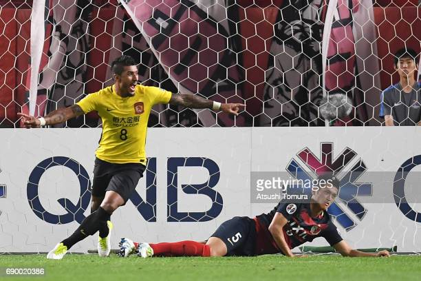 Paulinho of Guangzhou Evergrande celebrates after scoring a goal during the AFC Champions League Round of 16 match between Kashima Antlers and...