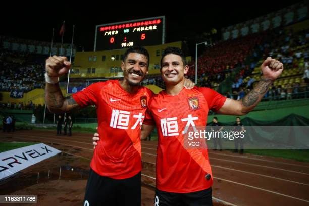 Paulinho of Guangzhou Evergrande celebrates with team mate Elkeson after the 2019 Chinese Football Association Super League 19th round match between...
