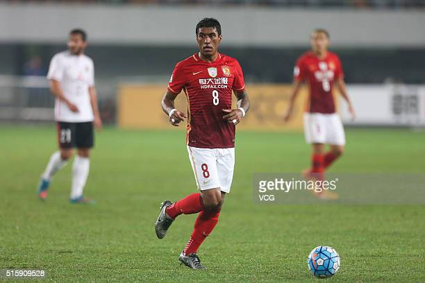 Paulinho of Guangzhou Evergrande drives the ball during the AFC Champions League Group H match between Guangzhou Evergrande and Urawa Red Diamonds at...