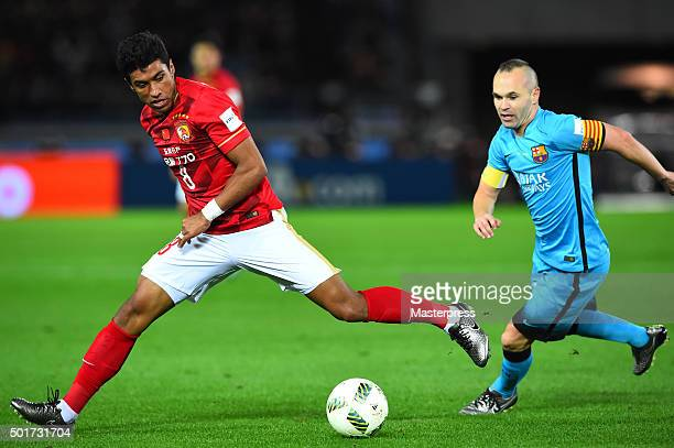 Paulinho of Guangzhou Evergrande FC and Andres Iniesta of Barcelona compete for the ball during the FIFA Club World Cup Semi Final match between...
