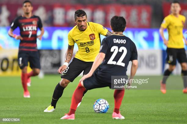 Paulinho of Guangzhou Evergrande in action during the AFC Champions League Round of 16 match between Kashima Antlers and Guangzhou Evergrande FC at...