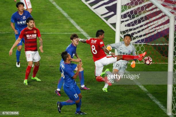 Paulinho of Guangzhou Evergrande shoots during the eighth round match of 2017 Chinese Football Association Super League between Guangzhou Evergrande...