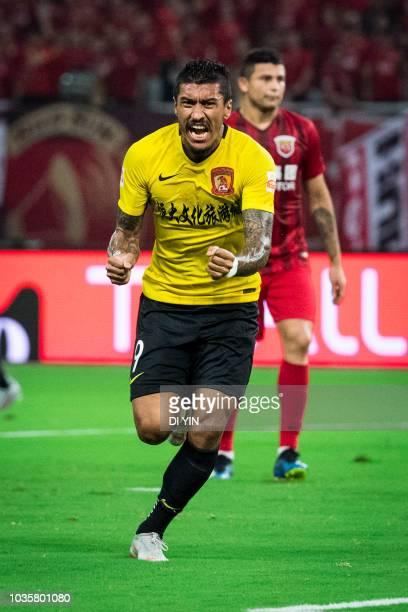 Paulinho of Guangzhou Evergrande Taobao celebrates a goal during the 2018 Chinese Super League match between Shanghai SIPG v Guangzhou Evergrande...