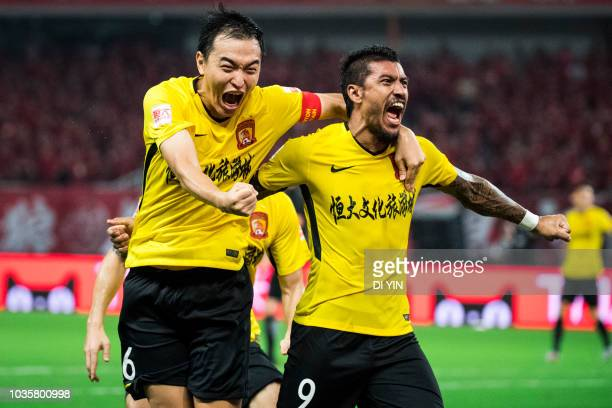 Paulinho of Guangzhou Evergrande Taobao celebrates a goal with Feng Xiaoting during the 2018 Chinese Super League match between Shanghai SIPG v...