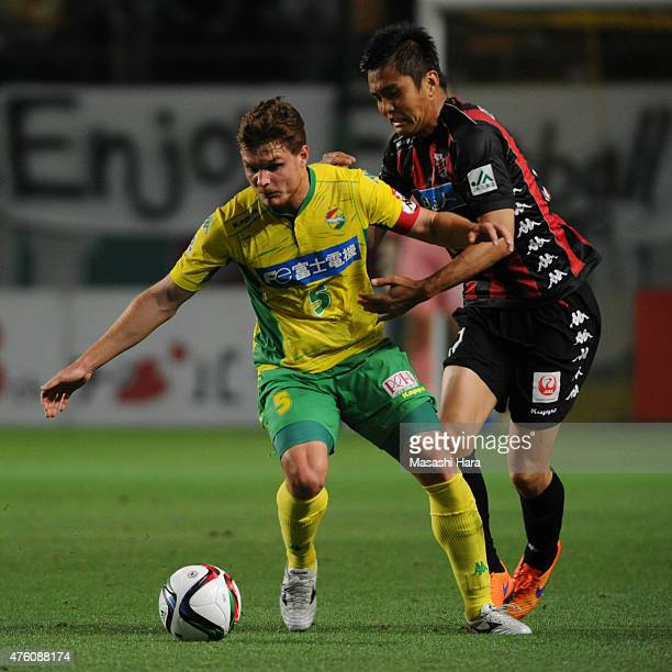 Paulinho of JEF United Chiba and Junichi Inamoto of Consadole Sapporo compete for the ball during the JLeague second division match between JEF...