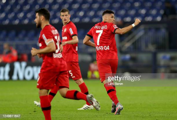 Paulinho of Leverkusen celebrates after he scores the equalizing goal during the Bundesliga match between FC Schalke 04 and Bayer 04 Leverkusen at...
