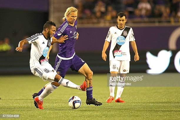 Paulinho of Ponte Preta kicks the ball in front of Brek Shea of Orlando City SC during an international friendly soccer match between Brazil's Ponte...