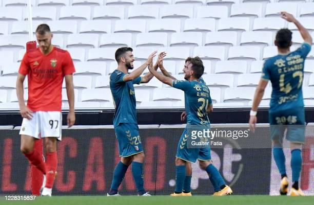 Paulinho of SC Braga celebrates with teammates after scoring a goal during the Pre Season Friendly match between SL Benfica and SC Braga at Estadio...