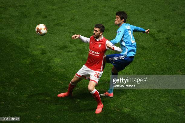 Paulinho of SC Braga competes for the ball with Hiroki Sakai of Marseille during UEFA Europa League Round of 32 match between Sporting Braga and...
