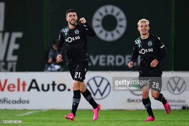 Paulinho of Sporting CP celebrates with Pedro Goncalves after scores his sides second goal the Liga NOS match between Rio Ave FC and Sporting CP at...