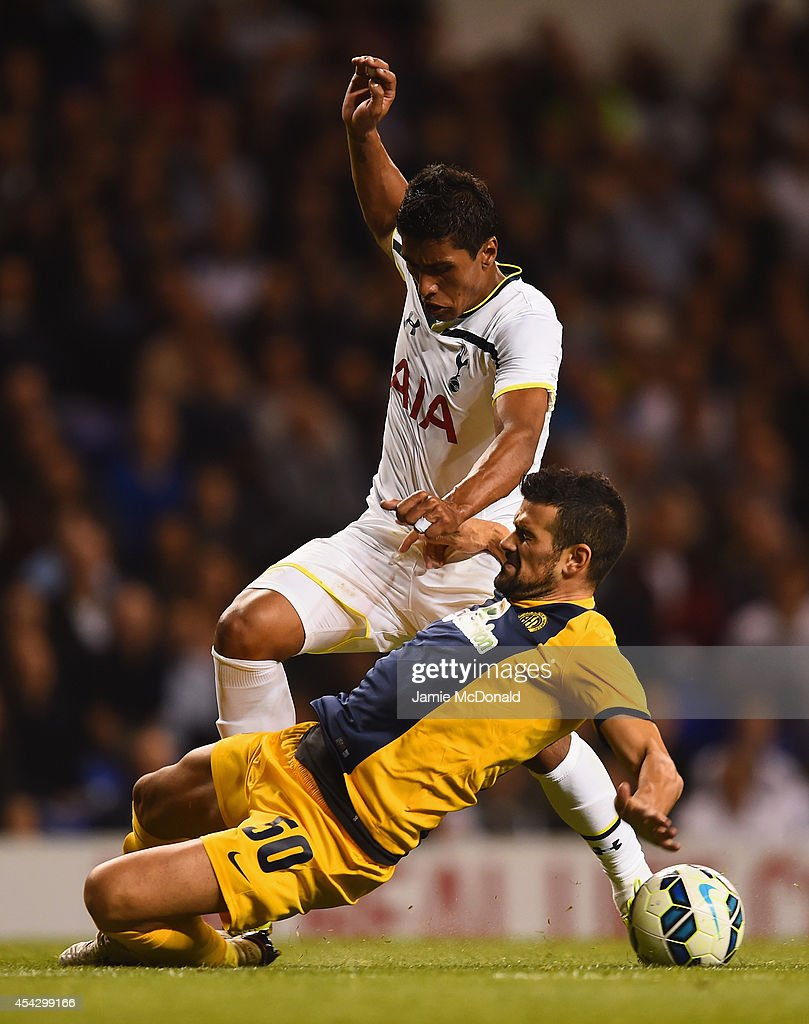 Paulinho of Spurs is tackled by Ricardo Manuel Ferreiras Sousa of AEL Limassol during the UEFA Europa League Qualifying Play-Offs Round Second Leg match between Tottenham Hotspur and AEL Limassol FC on August 28, 2014 in London, United Kingdom.