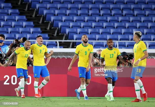 Paulinho of Team Brazil celebrates after scoring their side's fourth goal during the Men's First Round Group D match between Brazil and Germany...