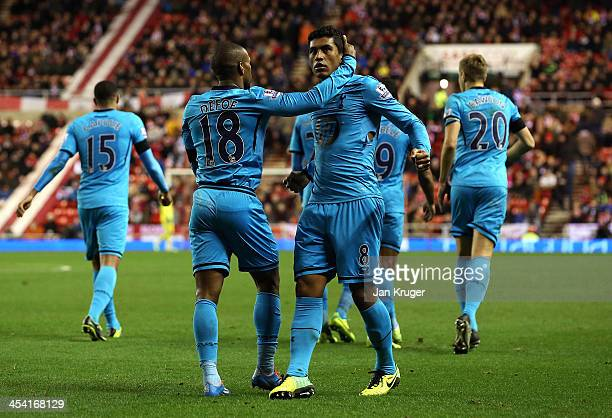 Paulinho of Tottenham celebrates his goal with team mates during the Barclays Premier League match between Sunderland and Tottenham Hotspur at the...