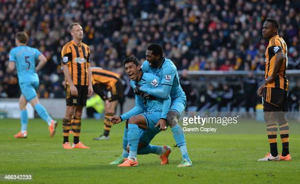 Paulinho of Tottenham Hotspur celebrates scoring a goal with his teammate Emmanuel Adebayor during the Barclays Premier League match between Hull...