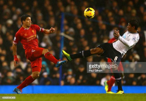 Paulinho of Tottenham Hotspur fouls Luis Suarez of Liverpool during the Barclays Premier League match between Tottenham Hotspur and Liverpool at...