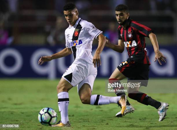 Paulinho of Vasco da Gama struggles for the ball with Gustavo Cascardo of Atletico PR during a match between Vasco da Gama and Atletico PR as part of...