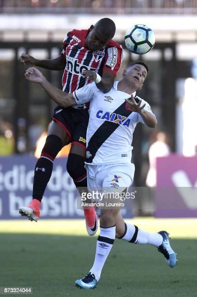 Paulinho of Vasco da Gama struggles for the ball with Jucilei of Sao Paulo during the match between Vasco da Gama and Sao Paulo as part of...