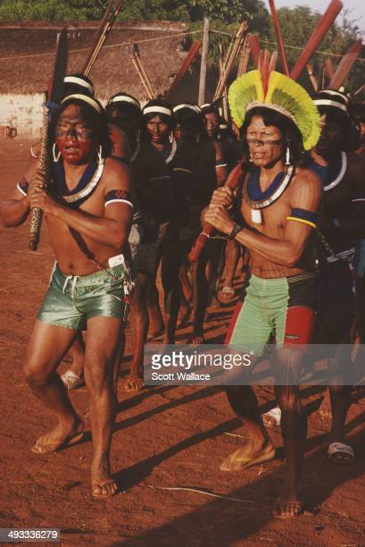 Paulinho Paiakan a leader of the Kayapo people performs a war dance in the Amazon Basin Brazil 1992