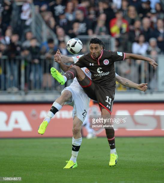 Pauli's Aziz Bouhaddouz and Sandhausen's Markus Karl vie for the ball during the 2 German Bundesliga soccer match between FC St Pauli and SV...