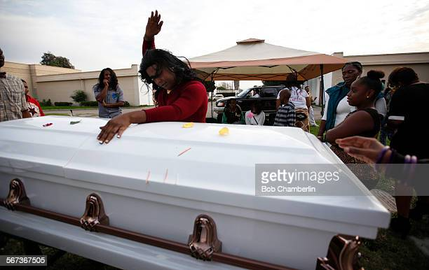 Paulisha Thomas finishes a dance in honor of Deshwanda Sanchez at her coffin at Angeles Abby Memorial Park in Compton on DECEMBER 19 2014 Sanchez a...