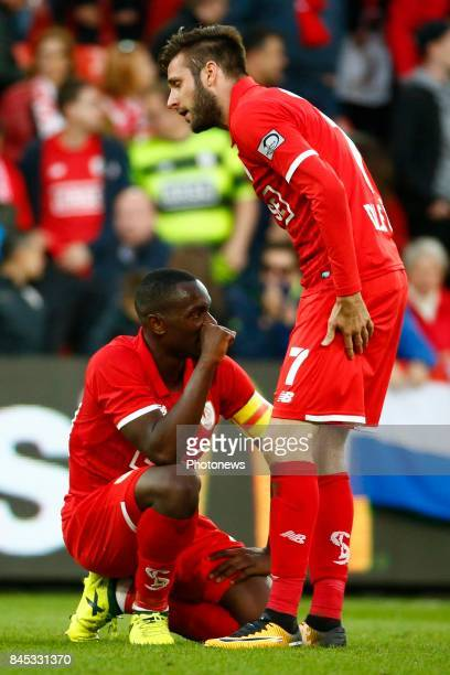 PaulJose Mpoku forward of Standard Liege and Duje Cop midfielder of Standard Liege during the Jupiler Pro League match between Standard de Liege and...