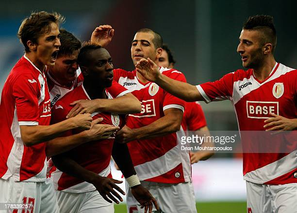 PaulJose M'Poku of Standard Liege celebrates scoring the first goal of the game with team mates during the Second Leg Play Off UEFA Europa League...