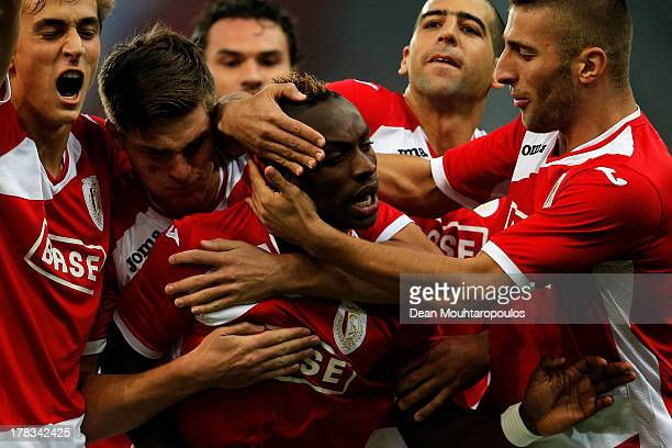 PaulJose M'Poku of Standard Liege celebrates scoring the first goal of the game with teammates during the UEFA Europa League playoff second leg...