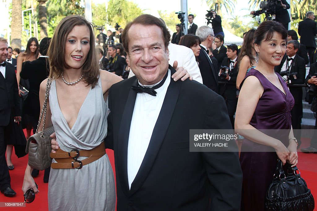 Paul-Loup Sulitzer arrives with companion finance consultant Annabelle Rahal for the screening of 'Utomlyonnye Solntsem 2: Predstoyanie' (The Exodus - Burnt By The Sun 2) presented in competition at the 63rd Cannes Film Festival on May 22, 2010 in Cannes.