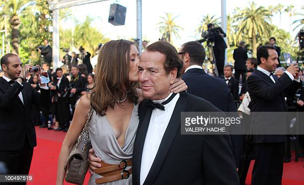PaulLoup Sulitzer is kissed by companion finance consultant Annabelle Rahal as they arrive for the screening of 'Utomlyonnye Solntsem 2 Predstoyanie'...