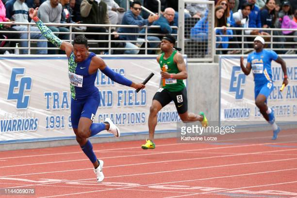 Paulo Andre Camilo crosses the finish line in the men's 400 meter relay on the second day of the 61st Mt SAC Relays at Murdock Stadium at El Camino...