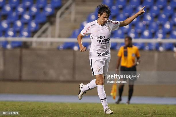 Paulo Andre of Corinthians celebrates a scored goal against Botafogo during a match as part of the Brazilian Championship 2010 at Engenhao Stadium on...