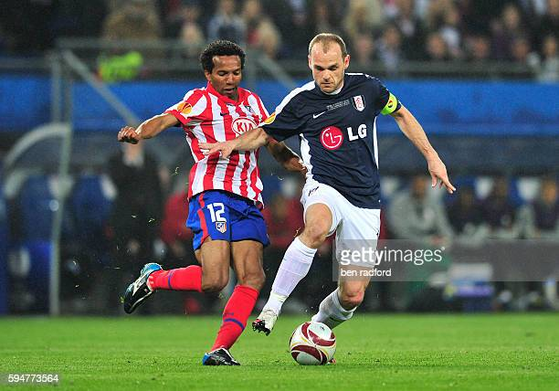 Paulo Assuncao of Atletico Madrid and Danny Murphy of Fulham during the UEFA Europa League Cup Final between Club Atletico de Madrid and Fulham at...