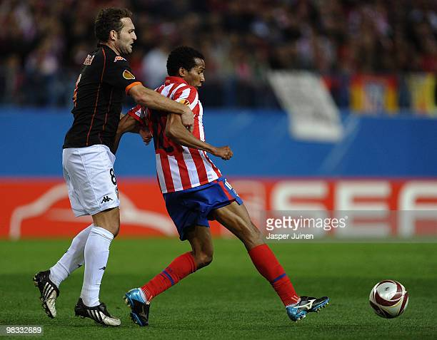Paulo Assuncao of Atletico Madrid in action with Ruben Baraja of Valencia during the UEFA Europa League quarter final second leg match between...