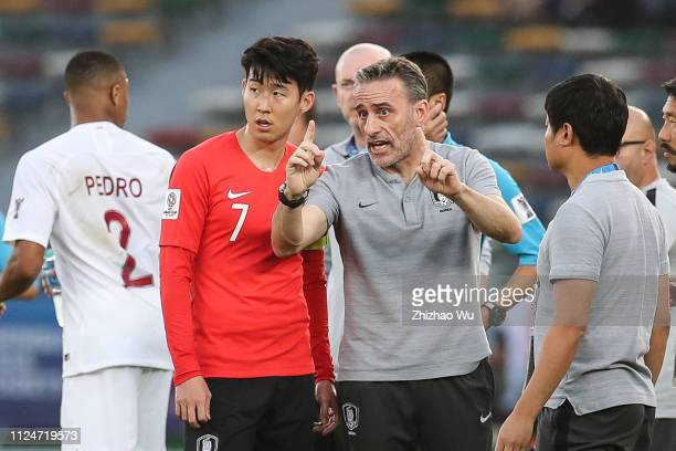Paulo Bento coach of South Korea talks to Son Heungmin of South Korea during the AFC Asian Cup quarter final match between South Korea and Qatar at...