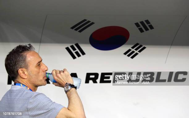 Paulo Bento the head coach / manager of South Korea has a drink of water during the AFC Asian Cup Group C match between South Korea and Philippines...