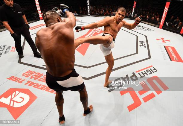 Paulo Borrachinha of Brazil kicks Oluwale Bamgbose in their middleweight bout during the UFC 212 event at Jeunesse Arena on June 3 2017 in Rio de...
