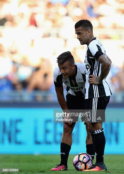Paulo Bruno Exequiel Dybala and Dani Alves Da Silva of Juventus FC looks onduring the Serie A match between SS Lazio and Juventus FC at Stadio...