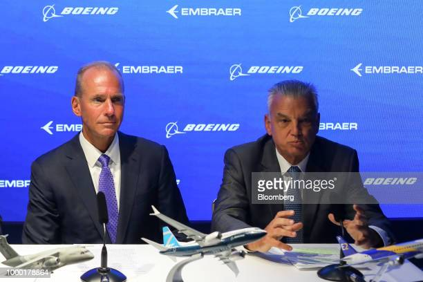 Paulo Cesar Silva chief executive officer at Embraer SA right speaks while sitting next to Dennis Muilenburg chief executive officer of Boeing Co...