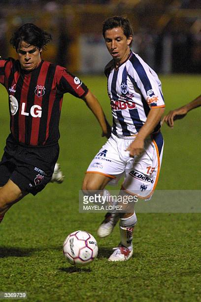 Paulo Chavez of the Mexican team Monterrey fights for the ball against Cristian Montero from the Costa Rican team Liga Deportiva Alajuelense 14 April...