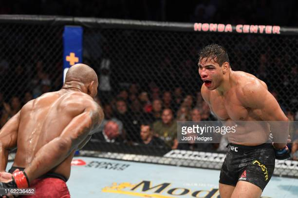 Paulo Costa of Brazil and Yoel Romero of Cuba taunt each other in their middleweight bout during the UFC 241 event at the Honda Center on August 17...