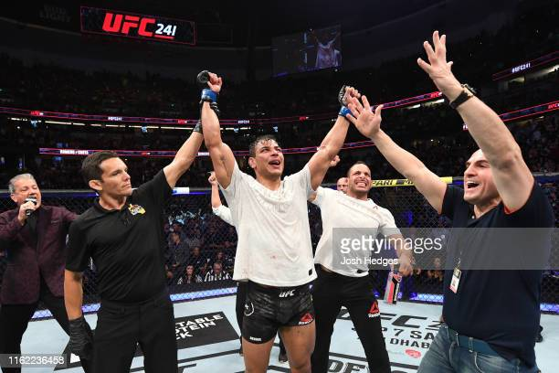 Paulo Costa of Brazil celebrates his victory over Yoel Romero of Cuba in their middleweight bout during the UFC 241 event at the Honda Center on...