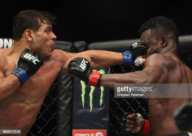 Paulo Costa of Brazil punches Uriah Hall of Jamaica in their middleweight fight during the UFC 226 event inside TMobile Arena on July 7 2018 in Las...