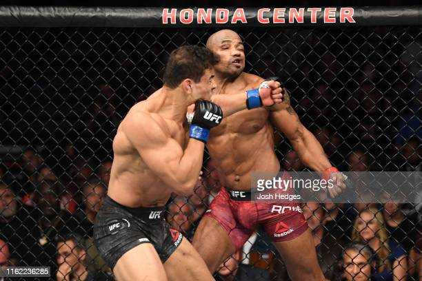 Paulo Costa of Brazil punches Yoel Romero of Cuba in their middleweight bout during the UFC 241 event at the Honda Center on August 17 2019 in...