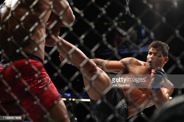 Paulo Costa sends a kick to Yoel Romero in the first round during their Middleweight Bout at UFC 241 at Honda Center on August 17, 2019 in Anaheim,...