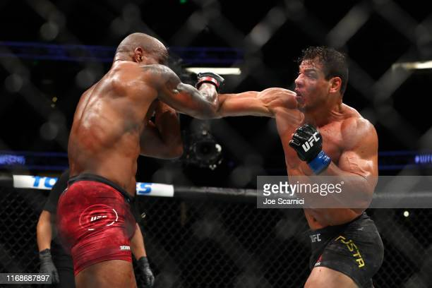 Paulo Costa throws a punch at Yoel Romero in the third round during their Middleweight Bout at UFC 241 at Honda Center on August 17 2019 in Anaheim...