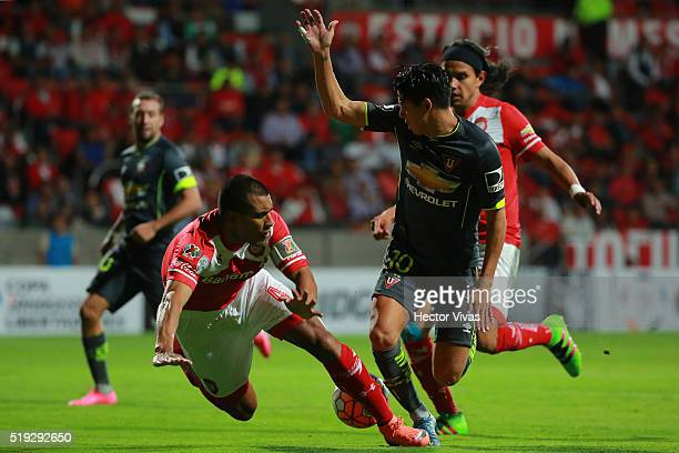 Paulo Da Silva and Gerardo Flores of Toluca struggles for the ball with Diego Morales of LDU Quito during a match between Toluca and LDU Quito as...