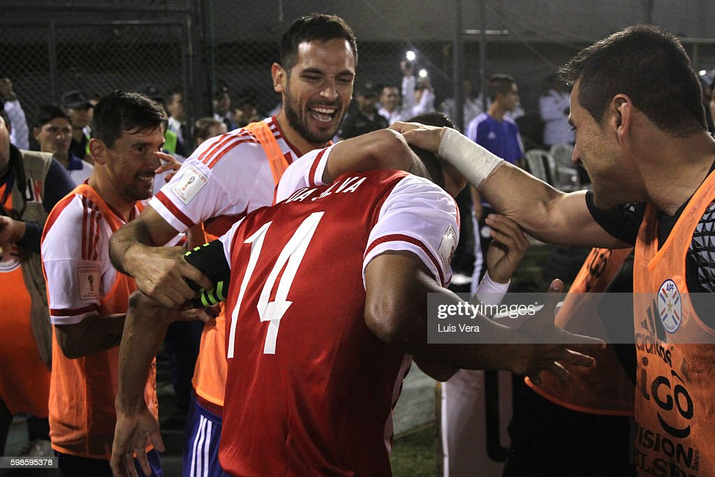 Paulo Da Silva of Paraguay celebrates with teammates after scoring the second goal of his team during a match between Paraguay and Chile as part of FIFA 2018 World Cup Qualifiers at Defensores del Chaco Stadium on September 01, 2016 in Asuncion, Paraguay.