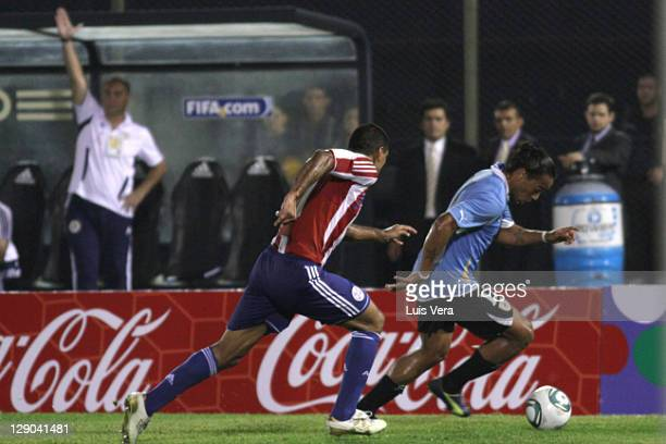 Paulo Da Silva of Paraguay, fights for the ball with Alvaro Pereira of Uruguay, during the match between Paraguay and Uruguay as part of the first...